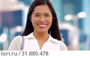 Купить «portrait of happy smiling asian woman in city», видеоролик № 31880478, снято 21 июля 2019 г. (c) Syda Productions / Фотобанк Лори