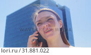 Купить «Low angle view of young caucasian businesswoman talking on mobile phone iin office balcony 4k», видеоролик № 31881022, снято 13 октября 2018 г. (c) Wavebreak Media / Фотобанк Лори