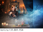 young witch in home. Halloween concept. Стоковое фото, фотограф Майя Крученкова / Фотобанк Лори