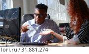 Купить «Front view of young mixed-race business team planning and working on desktop pc in modern office 4k», видеоролик № 31881274, снято 6 октября 2018 г. (c) Wavebreak Media / Фотобанк Лори