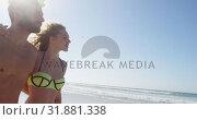 Купить «Romantic couple walking together at beach 4k», видеоролик № 31881338, снято 14 ноября 2018 г. (c) Wavebreak Media / Фотобанк Лори