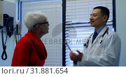 Купить «Young Asian male doctor examining a senior patient with tuning fork in the clinic 4k», видеоролик № 31881654, снято 25 ноября 2018 г. (c) Wavebreak Media / Фотобанк Лори