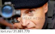 Купить «Close-up of caucasian military soldier looking through riflescope during training at base 4k», видеоролик № 31881770, снято 27 июня 2018 г. (c) Wavebreak Media / Фотобанк Лори