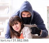 Купить «Armed man assaulting young woman at home», фото № 31882066, снято 15 декабря 2017 г. (c) Elnur / Фотобанк Лори