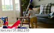 Side view of little black boy playing in a comfortable home 4k. Стоковое видео, агентство Wavebreak Media / Фотобанк Лори