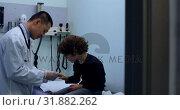 Купить «Side view of young asian male doctor examining a caucasian boy patient in a clinic 4k», видеоролик № 31882262, снято 25 ноября 2018 г. (c) Wavebreak Media / Фотобанк Лори