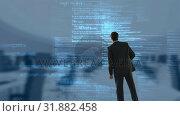 Купить «Businessman who watch data », видеоролик № 31882458, снято 20 декабря 2018 г. (c) Wavebreak Media / Фотобанк Лори