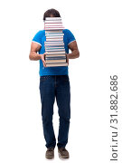 Male student with many books isolated on white. Стоковое фото, фотограф Elnur / Фотобанк Лори