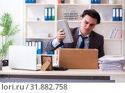 Купить «Young male employee being fired from his work», фото № 31882758, снято 18 февраля 2019 г. (c) Elnur / Фотобанк Лори