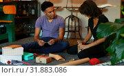 Купить «Front view of mixed-race young couple wrapping gift box in a comfortable home 4k», видеоролик № 31883086, снято 2 октября 2018 г. (c) Wavebreak Media / Фотобанк Лори