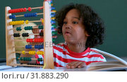 Купить «African American schoolboy learning mathematics with abacus at desk in a classroom 4k», видеоролик № 31883290, снято 10 ноября 2018 г. (c) Wavebreak Media / Фотобанк Лори