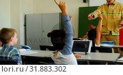 Купить «Schoolkids raising hands while male firefighter teaching about fire safety in the classroom 4k», видеоролик № 31883302, снято 10 ноября 2018 г. (c) Wavebreak Media / Фотобанк Лори