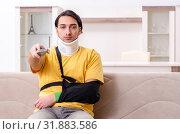 Купить «Young man after car accident suffering at home», фото № 31883586, снято 21 февраля 2019 г. (c) Elnur / Фотобанк Лори