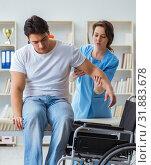 Купить «Patient undergoing rehabilitation recovery programme with doctor», фото № 31883678, снято 18 апреля 2017 г. (c) Elnur / Фотобанк Лори