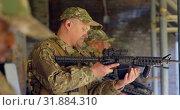 Купить «Side view of mixed-race military soldiers loading weapon during training 4k», видеоролик № 31884310, снято 27 июня 2018 г. (c) Wavebreak Media / Фотобанк Лори
