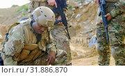 Купить «Mixed-race military soldiers planing on field during military training 4k», видеоролик № 31886870, снято 27 июня 2018 г. (c) Wavebreak Media / Фотобанк Лори