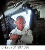 Купить «EARTH, THE MOON, Sea of Tranquility -- 20 Jul 1969 -- This interior view of the Apollo 11 Lunar Module (LM) shows astronaut Edwin E. Aldrin Jr. , lunar...», фото № 31897386, снято 11 декабря 2019 г. (c) age Fotostock / Фотобанк Лори