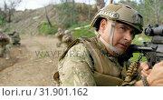 Купить «Front view of mid-adult caucasian military soldier showing hand signal on field during training 4k», видеоролик № 31901162, снято 27 июня 2018 г. (c) Wavebreak Media / Фотобанк Лори