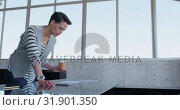 Купить «Beautiful Caucasian Businesswoman looking at document in modern office 4k», видеоролик № 31901350, снято 18 ноября 2018 г. (c) Wavebreak Media / Фотобанк Лори