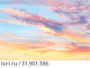 Купить «Heavenly abstract summer gentle background. Beautiful picturesque bright majestic dramatic evening morning sky at sunset or dawn in orange and blue in pastel colors. The sun rises on a warm day», фото № 31901586, снято 28 июня 2019 г. (c) Светлана Евграфова / Фотобанк Лори