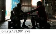 Купить «African American male trainer assisting boxer in wearing hand wrap in gym 4k», видеоролик № 31901778, снято 17 октября 2018 г. (c) Wavebreak Media / Фотобанк Лори