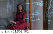 Купить «Woman wearing hijab taping quickly on laptop in her room with binary codes», видеоролик № 31902102, снято 16 января 2019 г. (c) Wavebreak Media / Фотобанк Лори