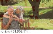 Купить «Senior couple sitting on a bench in a park  », видеоролик № 31902114, снято 16 января 2019 г. (c) Wavebreak Media / Фотобанк Лори