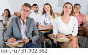 Купить «Group of students on lecture», фото № 31902362, снято 25 июля 2018 г. (c) Яков Филимонов / Фотобанк Лори