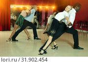 Купить «Couples enjoying latin dances», фото № 31902454, снято 4 октября 2018 г. (c) Яков Филимонов / Фотобанк Лори