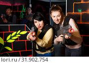 Купить «two emotional female laser tag players having fun in multinational team», фото № 31902754, снято 23 января 2019 г. (c) Яков Филимонов / Фотобанк Лори