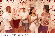 Купить «Young people in lost room with bloody walls», фото № 31902774, снято 8 октября 2018 г. (c) Яков Филимонов / Фотобанк Лори