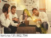 Купить «Young adults in escape room stylized as underground shelter», фото № 31902794, снято 8 октября 2018 г. (c) Яков Филимонов / Фотобанк Лори