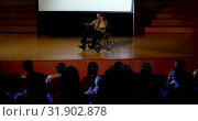 Mature Caucasian disabled businessman speaking in business seminar in auditorium 4k. Стоковое видео, агентство Wavebreak Media / Фотобанк Лори