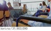 Купить «Businessman using laptop in the business seminar 4k», видеоролик № 31903090, снято 21 ноября 2018 г. (c) Wavebreak Media / Фотобанк Лори