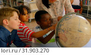 Купить «Young Asian female teacher teaching the kids about the globe at table in school library 4k», видеоролик № 31903270, снято 10 ноября 2018 г. (c) Wavebreak Media / Фотобанк Лори