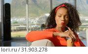 Купить «Thoughtful young African American female executive sitting on the sofa in office 4k», видеоролик № 31903278, снято 18 ноября 2018 г. (c) Wavebreak Media / Фотобанк Лори