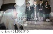 Купить «University student in cap and gown smiling with her friends», видеоролик № 31903910, снято 22 января 2019 г. (c) Wavebreak Media / Фотобанк Лори