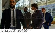 Купить «Mixed-race business people walking together in the lobby at office 4k», видеоролик № 31904554, снято 21 ноября 2018 г. (c) Wavebreak Media / Фотобанк Лори