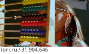 Купить «Side view of African American schoolgirl with spectacle learning math with abacus in classroom 4k», видеоролик № 31904646, снято 17 ноября 2018 г. (c) Wavebreak Media / Фотобанк Лори