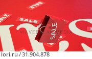 Купить «Digital animation of shopping bag against red sale pattern », видеоролик № 31904878, снято 22 января 2019 г. (c) Wavebreak Media / Фотобанк Лори