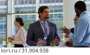 Купить «Multi ethnic business people interacting with each other during a seminar 4k», видеоролик № 31904938, снято 21 ноября 2018 г. (c) Wavebreak Media / Фотобанк Лори