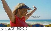 Купить «Side view of active senior Caucasian woman standing on a promenade at beach 4k», видеоролик № 31905010, снято 14 ноября 2018 г. (c) Wavebreak Media / Фотобанк Лори
