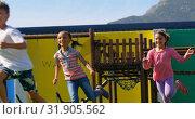 Купить «Front view of mixed-race schoolkids playing in the school playground 4k», видеоролик № 31905562, снято 17 ноября 2018 г. (c) Wavebreak Media / Фотобанк Лори