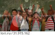 Купить «Pupils smiling and raising thumb in class», видеоролик № 31915162, снято 22 января 2019 г. (c) Wavebreak Media / Фотобанк Лори