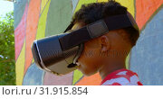 Купить «Side view of African American schoolboy using virtual reality headset in school playground 4k », видеоролик № 31915854, снято 17 ноября 2018 г. (c) Wavebreak Media / Фотобанк Лори