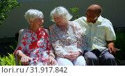 Купить «Group of active mixed-race senior friends interacting with each other in the garden of nursing home », видеоролик № 31917842, снято 22 ноября 2018 г. (c) Wavebreak Media / Фотобанк Лори