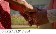 Купить «Mid section of senior couple holding hands in the garden of nursing home 4k», видеоролик № 31917854, снято 22 ноября 2018 г. (c) Wavebreak Media / Фотобанк Лори