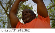 Купить «Low angle view of active African American senior man performing yoga in the garden of nursing home 4», видеоролик № 31918362, снято 22 ноября 2018 г. (c) Wavebreak Media / Фотобанк Лори