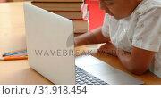 Купить «Side view of attentive Asian schoolboy studying with laptop in a classroom at school 4k», видеоролик № 31918454, снято 17 ноября 2018 г. (c) Wavebreak Media / Фотобанк Лори
