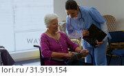 Купить «Front view of Caucasian female doctor and senior woman discussing over digital tablet at nursing hom», видеоролик № 31919154, снято 22 ноября 2018 г. (c) Wavebreak Media / Фотобанк Лори